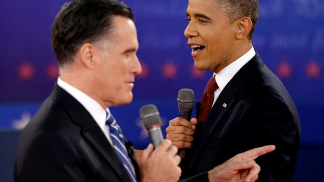 FILE - In this Oct. 16, 2012 file photo, President Barack Obama, right, and Republican presidential candidate, former Massachusetts Gov. Mitt Romney exchange views during the second presidential debate at Hofstra University in Hempstead, N.Y. Obama and Romney, bitter campaign foes just weeks ago, are to share a lunch on Thursday, Nov. 29, 2012, at the White House with an eye on overlapping interests rather than the sharp differences that defined their presidential contest. (AP Photo/David Goldman, File) ORG XMIT: WX102