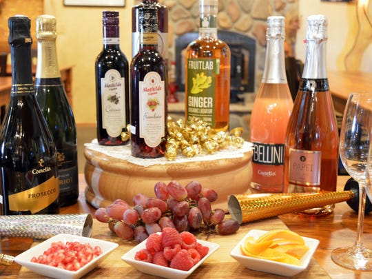 Set out a variety of bubblies and other liquors along with fresh garnishes.