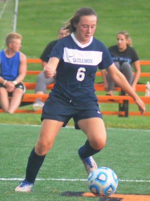 Saddle Brook's Mia Larsen pushing the ball up field against Hasbrouck Heights.