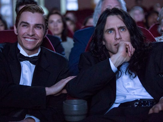 """Greg Sestero (Dave Franco, left) and Tommy Wiseau (James Franco) attend the premiere of Wiseau's movie """"The Room"""" in """"The Disaster Artist."""""""
