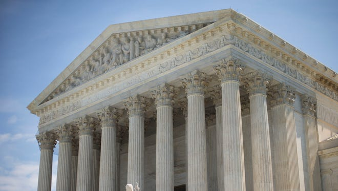 Saturday's order from the Supreme Court overturns an appeals court decision a day earlier that blocked the Arizona law.