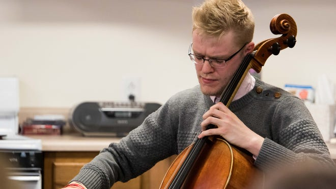 Cellist Jacob Shaw performs Bach's Cello Suite No. 1 for residents of NorthPointe Woods on Thursday.