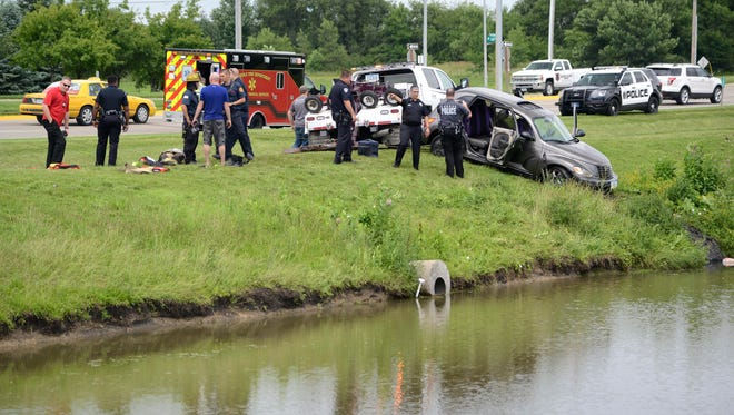 Fire and rescue crews pulled a woman and her car out of a pond Tuesday afternoon near1450 E. Hickman Road in Waukee, authorities said.