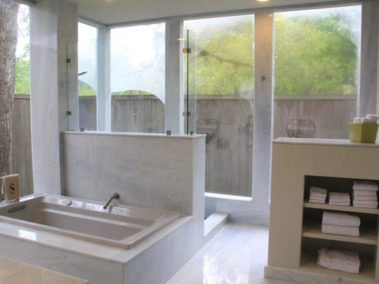 The modern, clean lines of the luxurious master bath.