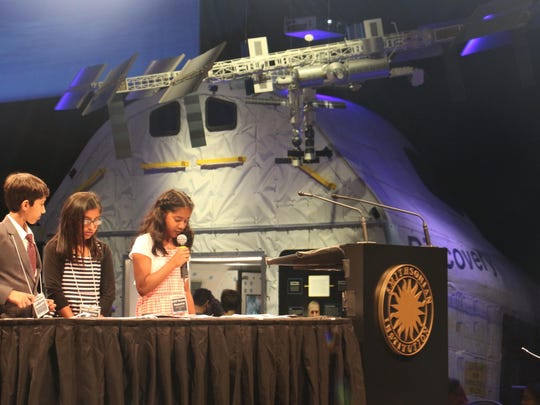 Thomas Edison EnergySmart Charter School fourth-graders, from left, Panav Gala, Jiya Patel and Raina Desai, took part in a space flight conference last month at the National Air and Space Museum in Washington, D.C.