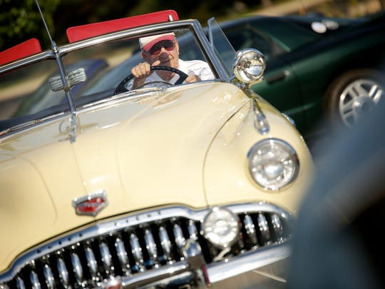 Steve Harvilla, 88, of Novi attends the car blessing, driving his 1949 Buick Super Convertible to the parking lot of St. James Church on Thursday. About 20 cars were blessed at the event.