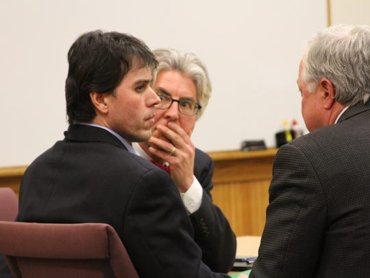 Raulie Casteel, foreground, listens to his attorney, Douglas Mullkoff, right, after the jury read its guilty verdict in 2014. Also pictured is defense attorney Charles Groh.