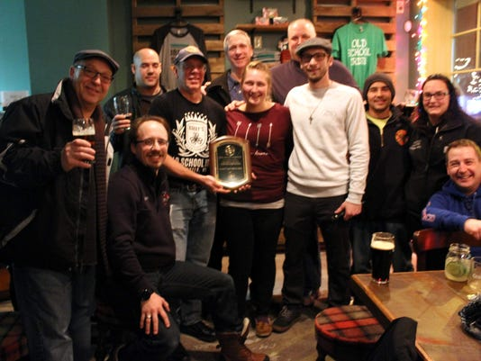 Several WFD firefighters were on hand at Barry's Old School Irish Friday night to accept a plaque in honor of their dedication and friendship. (M. Rosenberry)