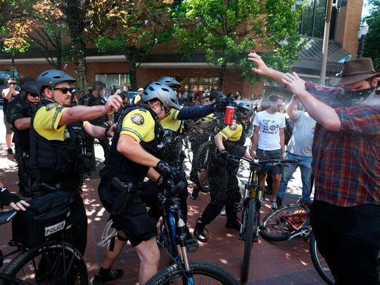 Police use pepper spray during rival protests June 19 in downtown Portland, Ore.