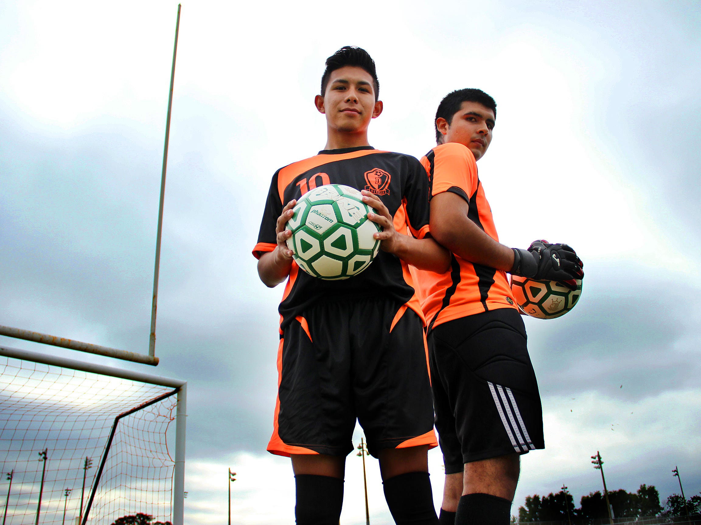 Seniors Jose Valencia (left) and Octavio Abella (right) have helped change the culture of the Dunbar boys soccer program after a 2011-12 season where the Tigers went 0-18