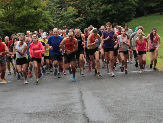 Barry_Hopkins_run_along_Olana_Lake_2013_-_photo_credit_Sarah_Hasbrook.JPG