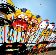 SURABAYA, INDONESIA - SEPTEMBER 14: Kites are displayed during The 4th Surabaya International Kite Festival and Competition on September 14, 2014 in Surabaya, Indonesia. The 4th Surabaya International Kite Festival and Competition attracts hundreds of kite enthusiasts from all over Indonesia and two international participants from Malaysia and Sweden in Edu Park, Pakuwon City, Surabaya.  (Photo by Robertus Pudyanto/Getty Images)