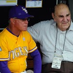 LSU Tigers head coach Paul Mainieri talks with former head coach Skip Bertman prior to the game against the TCU Horned Frogs in the 2015 College World Series at TD Ameritrade Park.