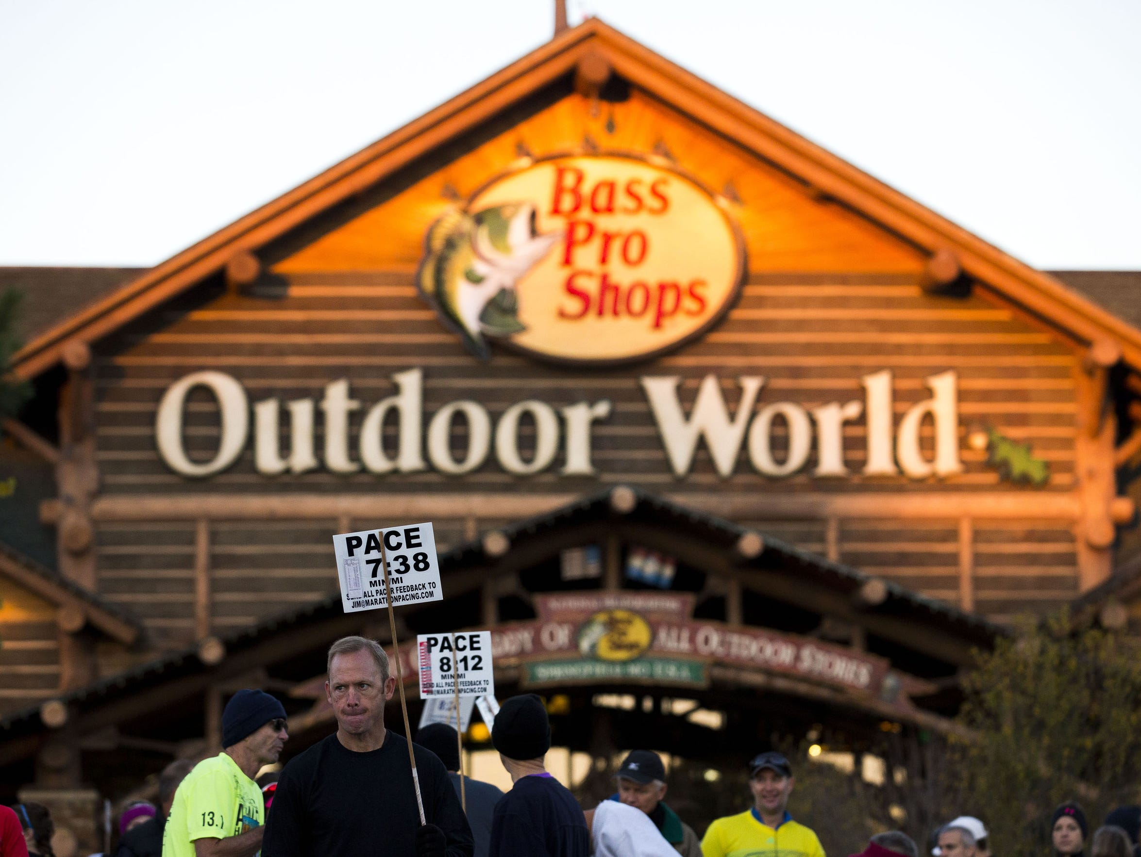Runners wait for a race to begin in front of Bass Pro's