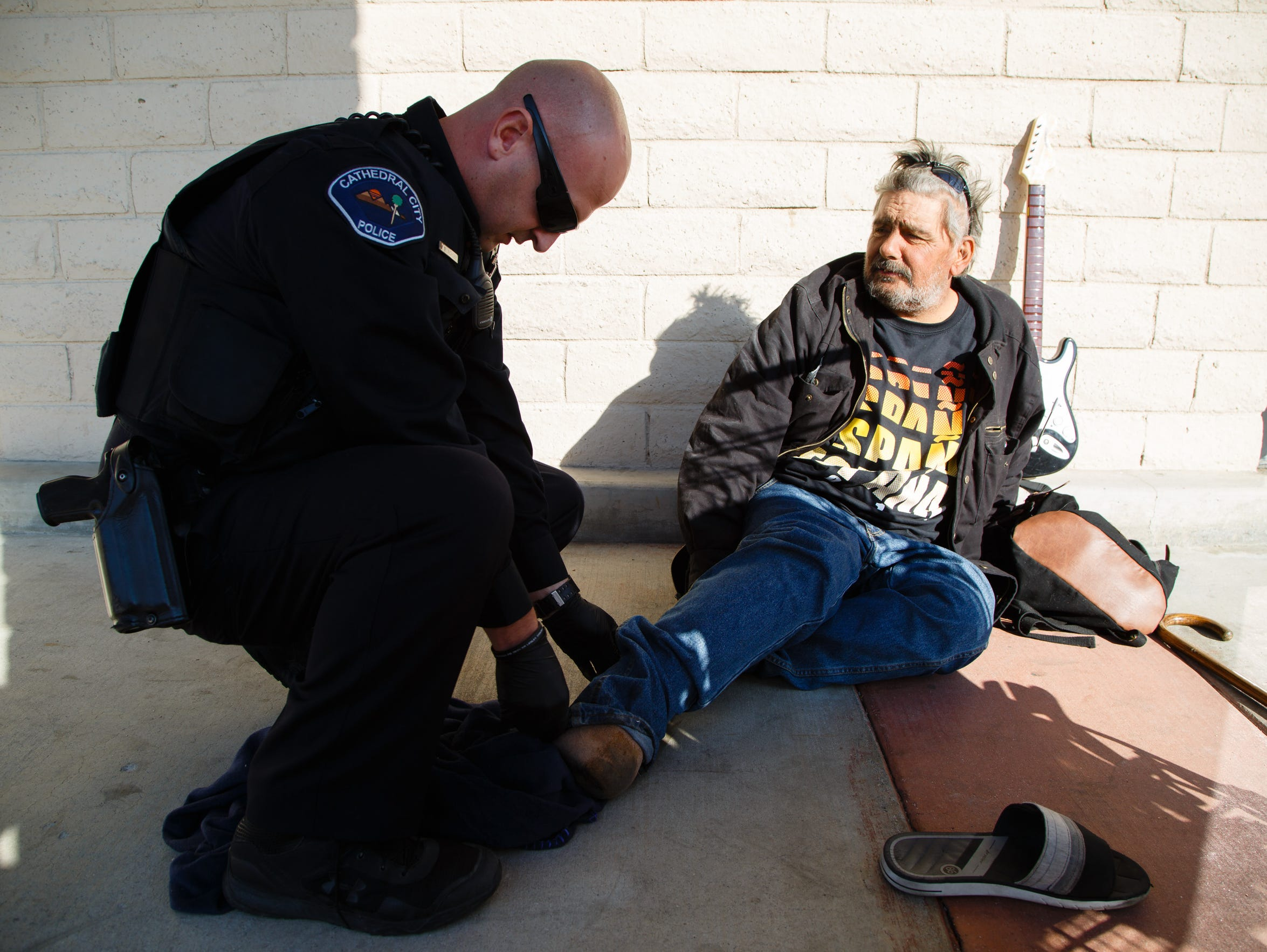 police officer reunites homeless people families officer jeff blatchley encourages george raikoglo to