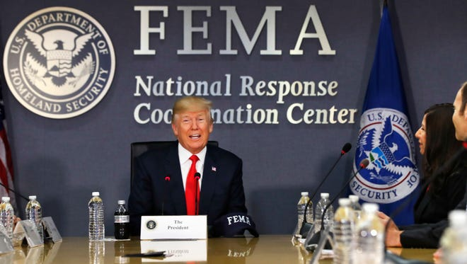 President Donald Trump meets with emergency officials to discuss the hurricane season, Friday, Aug. 4, 2017, at Federal Emergency Management Agency (FEMA) headquarters in Washington. At right is Acting Homeland Security Secretary Elaine Duke.