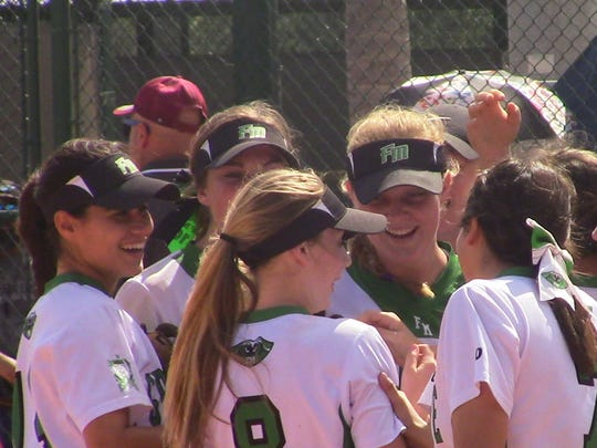 Teammates congratulate Riley Sanders (8) after throwing out a runner at the plate from center field in Wednesday's 5-4 loss to Pembroke Pines Charter in the 7A state semifinal in Vero Beach.
