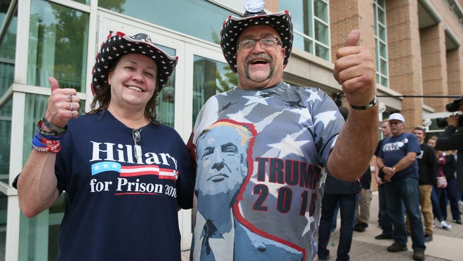 Cindy Hoffman of Independence, Iowa,  and Randal Thom of Lakefield, Minn., wait to enter a Donald Trump campaign rally Monday in Green Bay.