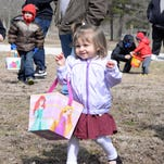 Abigail Gentile, 2, of Vineland, was delighted after collecting Easter eggs in her bag during a hunt at Giampietro Park in Vineland on Saturday, March 28, 2015.  Staff photo/Charles J. Olson