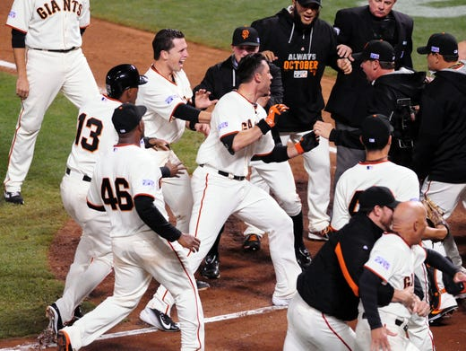 From wild cards to World Series, Giants, Royals endured