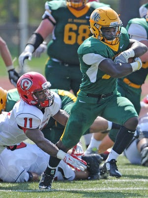 Elijah Fort (30) rushed for 754 yards and 16 touchdowns last year to help St. Norbert College win the the Midwest Conference title and go 10-1 overall.