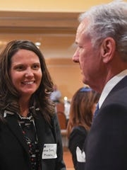 Leesa Owens, left, talks with Gov. Henry McMaster during an Anderson Area Chamber of Commerce Business Luncheon at the Hilton Garden Inn in Anderson in 2017.