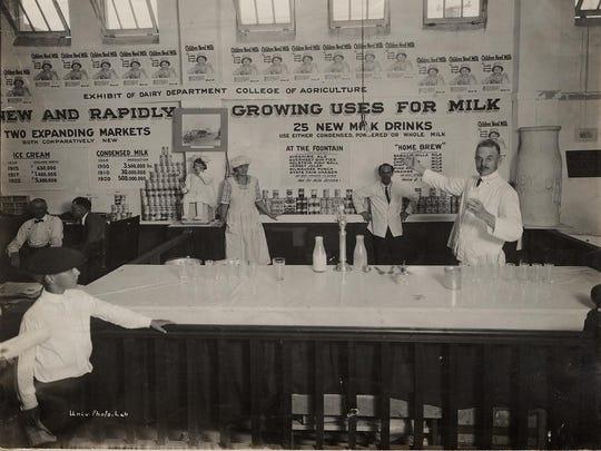 Men and women work in the University of Wisconsin dairy