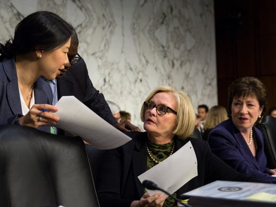 Sen. Claire McCaskill (D-Mo.) speaks with an aide before a hearing on Capitol Hill in Washington.