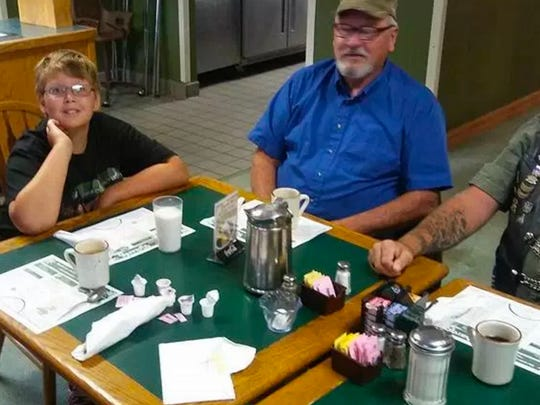 Phil Mick has breakfast with members of his motorcycle escort before school.