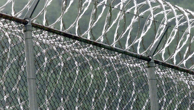 Fencing and razor wire surround  the Southport Correctional Facility.