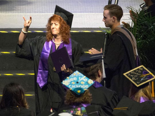 Cathy Hocking accepts a diploma on behalf of her daughter, Karli Richardson during Grand Canyon University commencement in Phoenix on April 27, 2017. Karli and her sister, Kelsey, were both killed in the wrong-way crash on I-17 on Good Friday. Hocking said she was proud to accept her daughter's diploma that recognized all of her hard work.