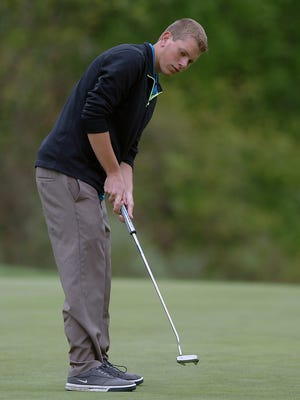 Lakeland's Justin LaFrance watches a putt during districts last year.