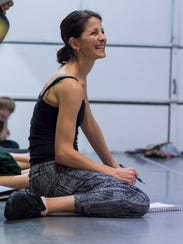 Artistic Director Amy Scarf laughs as she watches her