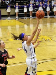 Huntingdon's Taylor Smith goes up for a layup during