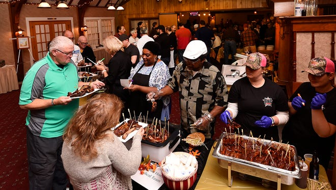 A photo from the 2016 Neighbor to Neighbor Volunteer Caregivers of Door County Rib Fest.  The sold-out fund raiser featured nine organization or business/restaurant-sponsored cooks in which 238 people judged the best of the ribs.