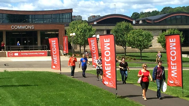 Students walk across the Corning Community College campus on Monday, the first day of classes for the fall semester.