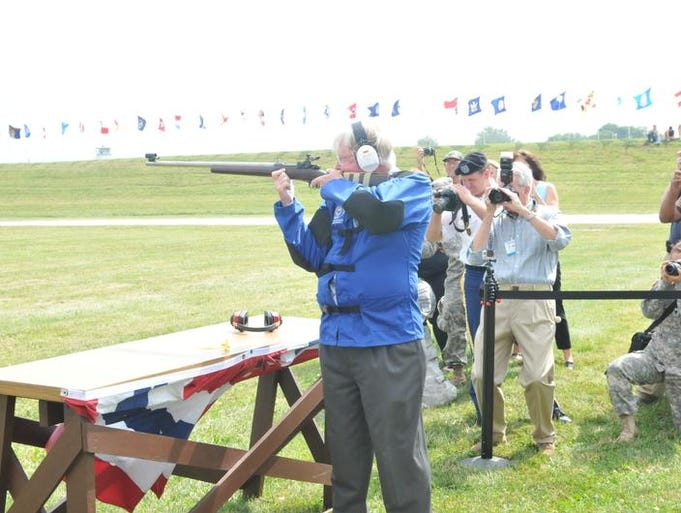 Olympic gold medalist Gary Anderson fires the first shot in the National Rifle and Pistol Matches on Monday, July 7, 2014, at Camp Perry.
