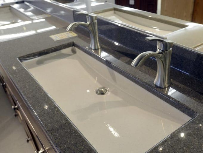 A double-faucet sink is on display at Handy Man Home Remodeling Center.