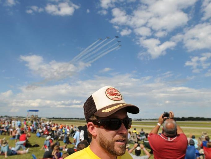 Travis Tortorige of Denver, Colo., sports a vintage 1982 EAA AirVenture hat during Saturday's air show at EAA AirVenture 2013 in Oshkosh, Wis., on August 3, 2013.