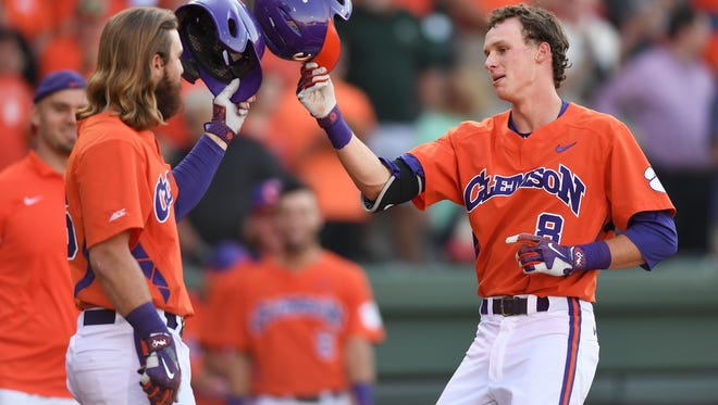 Clemson shortstop Logan Davidson (8) is met at home plate by Reed Rohlman after hitting a lead off home run in the 1st inning against Furman on Tuesday, May 9, 2017 at Fluor Field at The West End.