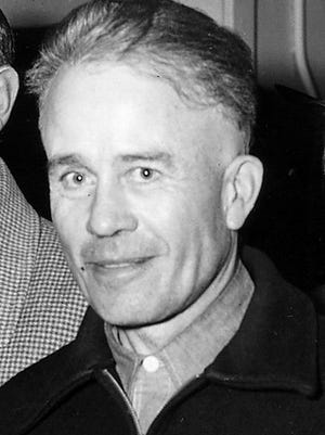 Ed Gein is shown at the time of his arrest in 1957, after murdering a woman at the local hardware store in Plainfield, Wis., and taking her body home to hang in his shed.