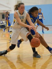 Sussex Central's Jada Smack fights for a loose ball