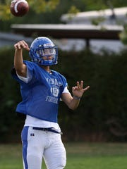 Trent Van Cleave throws during practice on Thursday, Aug. 20, 2015, at McNary High School in Keizer.