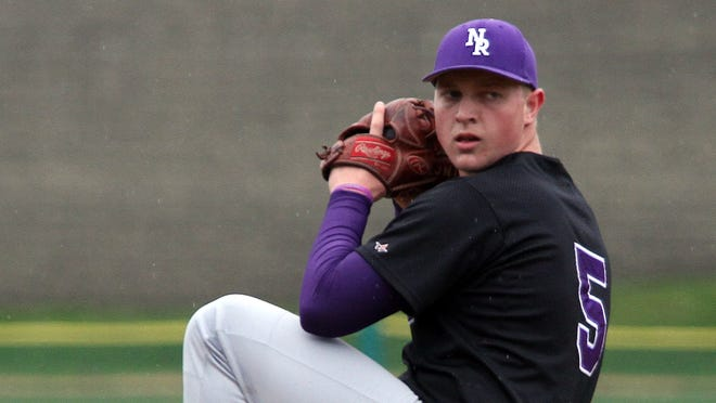 New Rochelle High School pitcher Louie Miceli delivers a pitch against White Plains during their baseball game in White Plains, April 29, 2014. New Rochelle beat White Plains, 5-1.