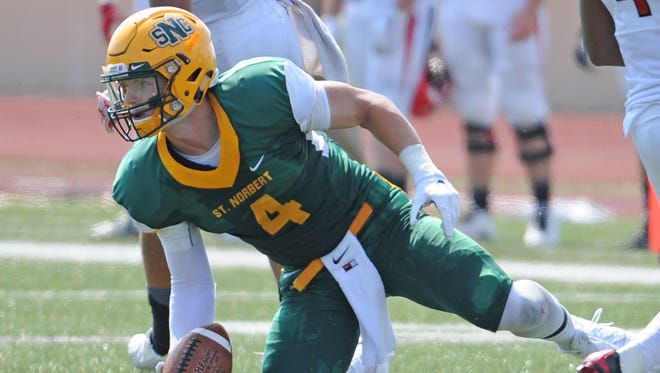 St. Norbert College senior Matt Freeman gets up after making a catch against Carthage College on Sept. 5. The Green Bay Southwest alum is playing football for the first time since 2010.