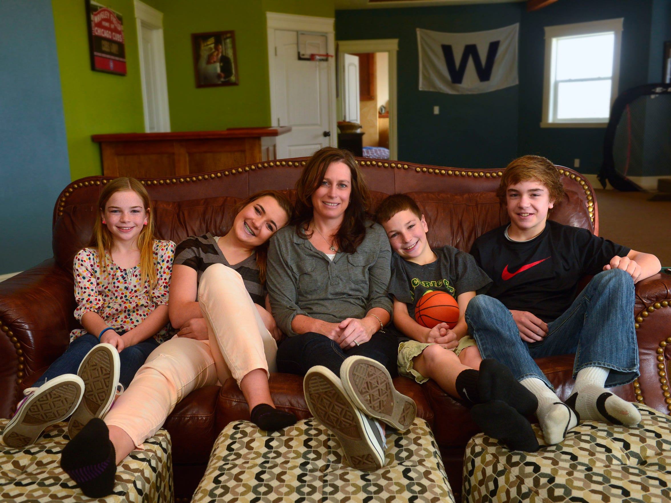 Kelli Gardner, center, sits with her children from