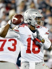Ohio State quarterback J.T. Barrett looks to pass against Penn State in the first half of an NCAA Division I college football game Saturday, Oct. 22, 2016, in Beaver Stadium.