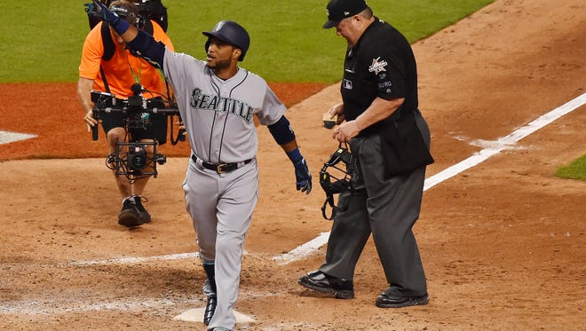 Robinson Cano rounds the bases after a solo home run in the 10th inning.