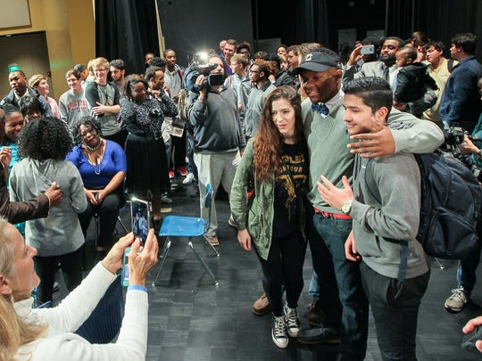 Pendleton High School senior Brad Johnson, middle, is congratulated by friends, teammates, and family after signing a letter of intent to play for the University of South Carolina football team, on Wednesday, February 1, during an assembly at the school in Pendleton.