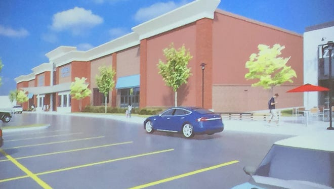 A photograph of an architectural rendering of a future Vortex Gymnastics Center in Green Oak Township. The facility is expected to build later this year.